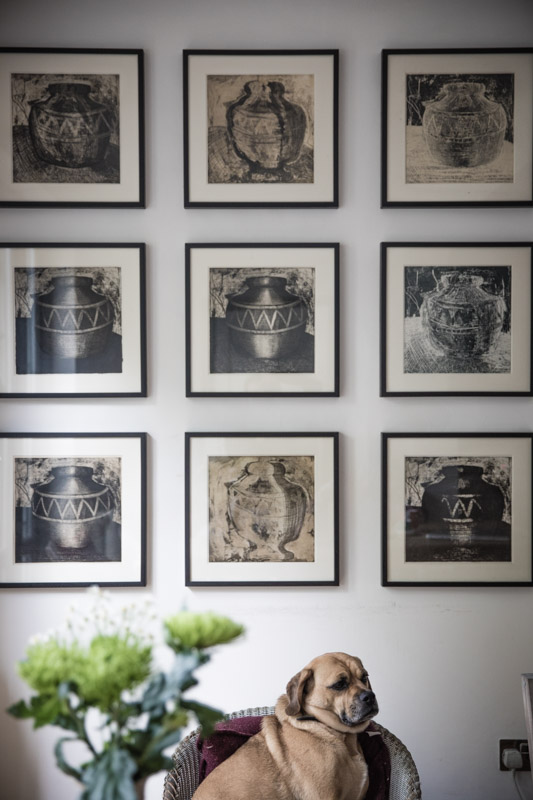 Symmetrical gallery wall flowers and dog