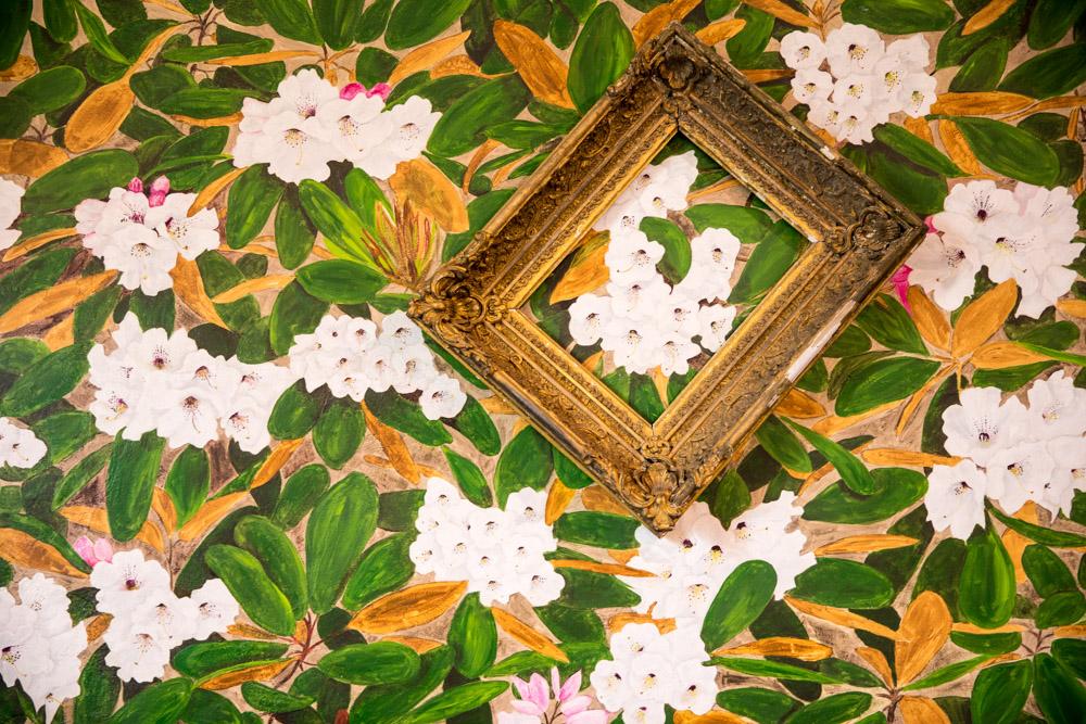 Gold frame framing wallpaper