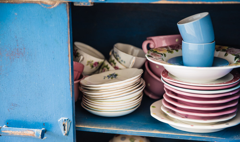 Tea set in blue cupboard
