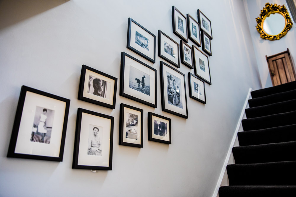 Stairs gallery wall of family photos