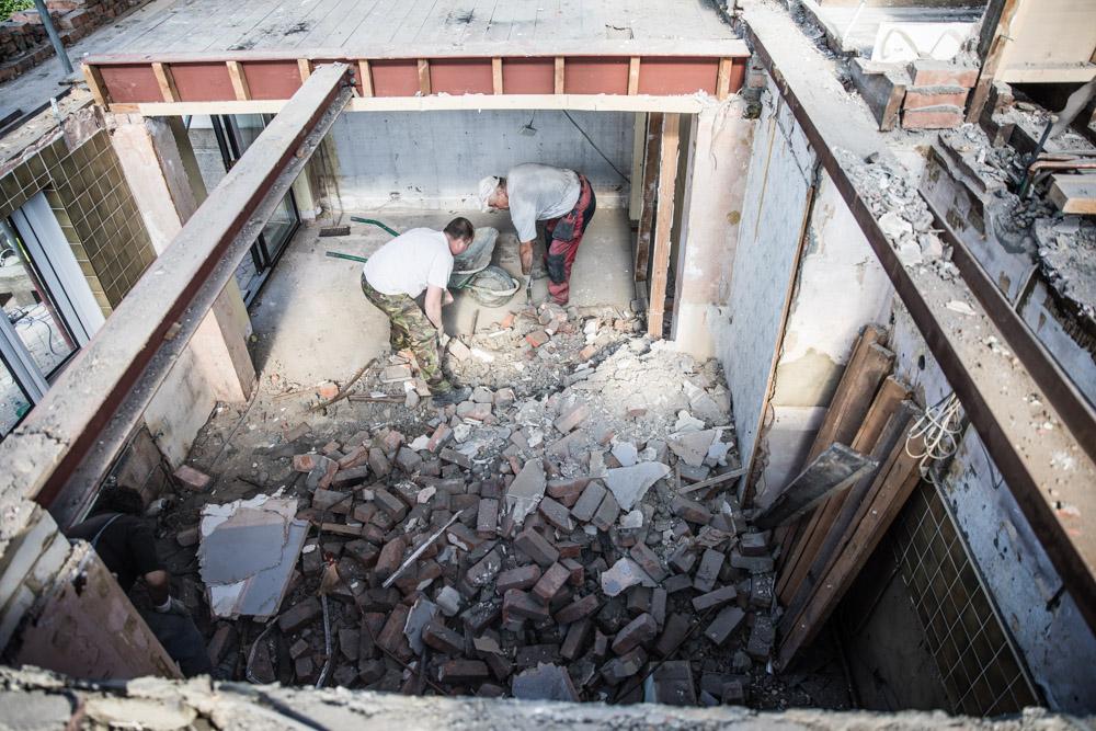 Demolishing the old kitchen. Photo courtesy of  John Ford