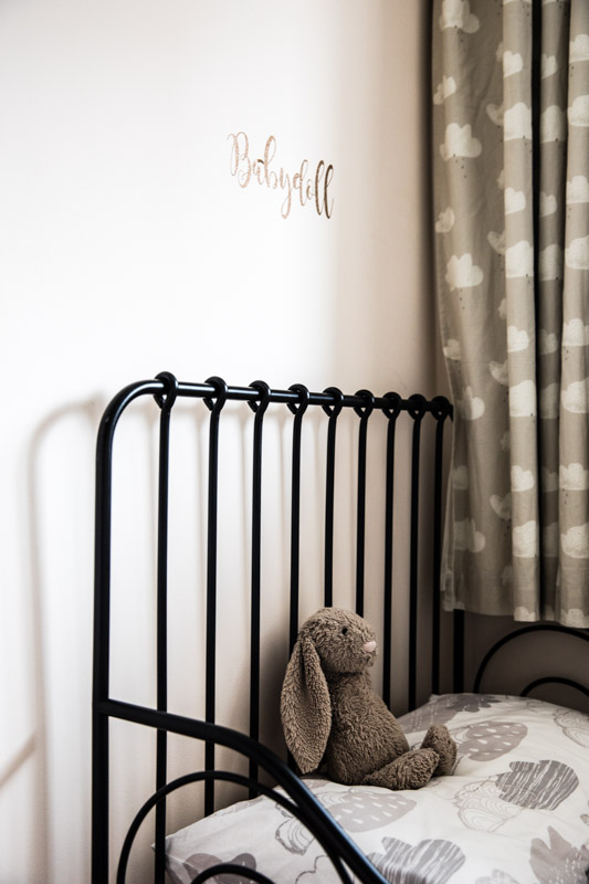 Girls bedroom black cast iron bed and clouds
