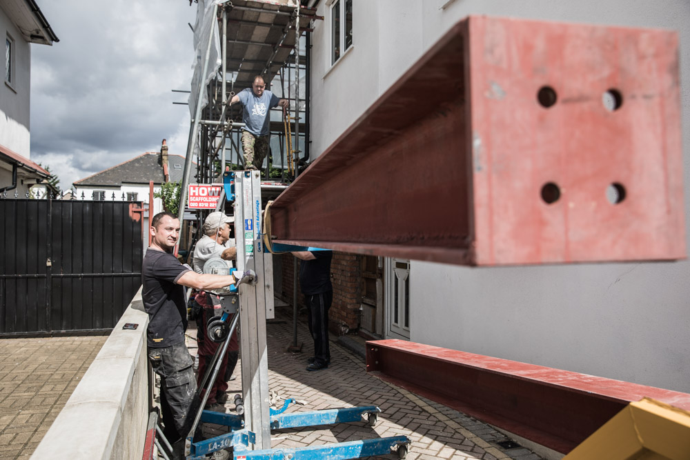 Inserting steels through a brick wall