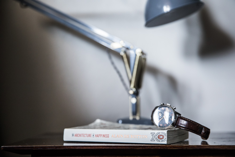 My husband's bedside table with his new Anglepoise Lamp