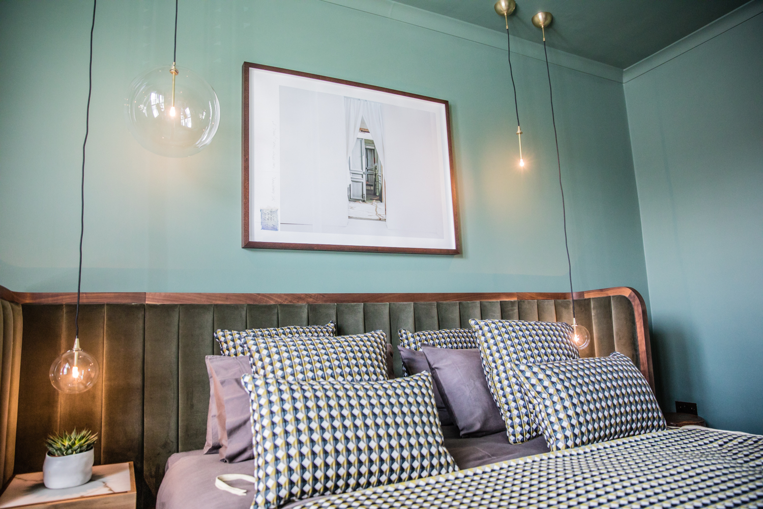 This gorgeous green bedroom is painted in Steam Engine by  Crown Paints
