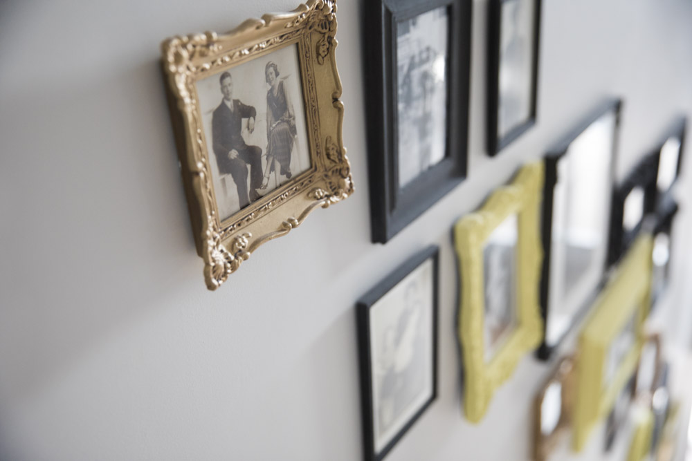 gallery wall - yellow and grey black and white familly photos