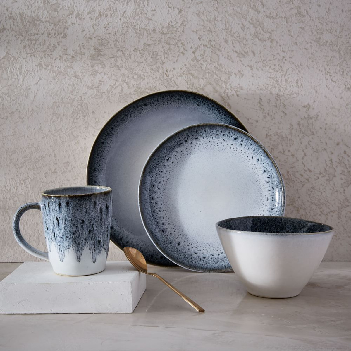 Really love this reactive glaze dinnerware set from  West Elm . It's got a bit of a retro feel and looks great with gold cutlery…