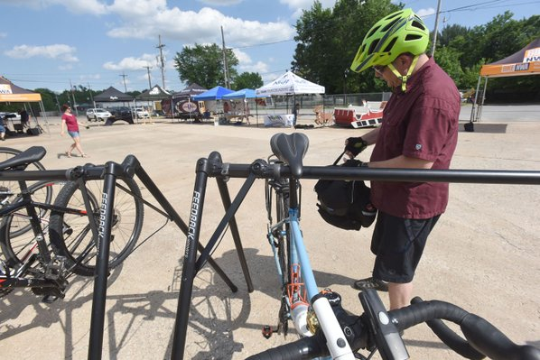 Eric Liberatore of Bella Vista parks his bike at the Ride Your Bike To Work Day party Friday at BikeNWA in Bentonville. Liberatore biked to his job on Friday.