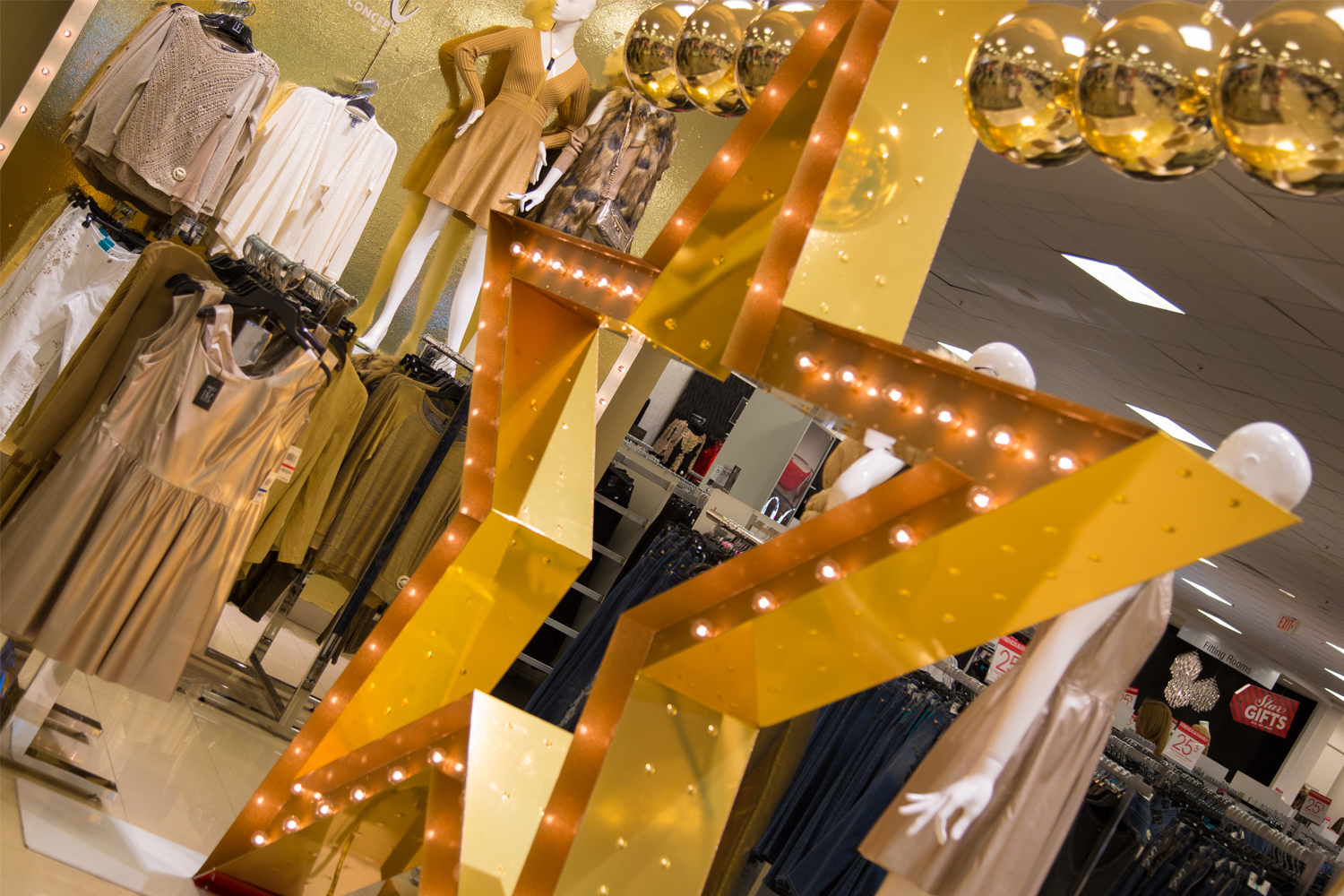 Metro Signs wraps inner and outer edges with shiny gold vinyl for Macy's gold star store display.