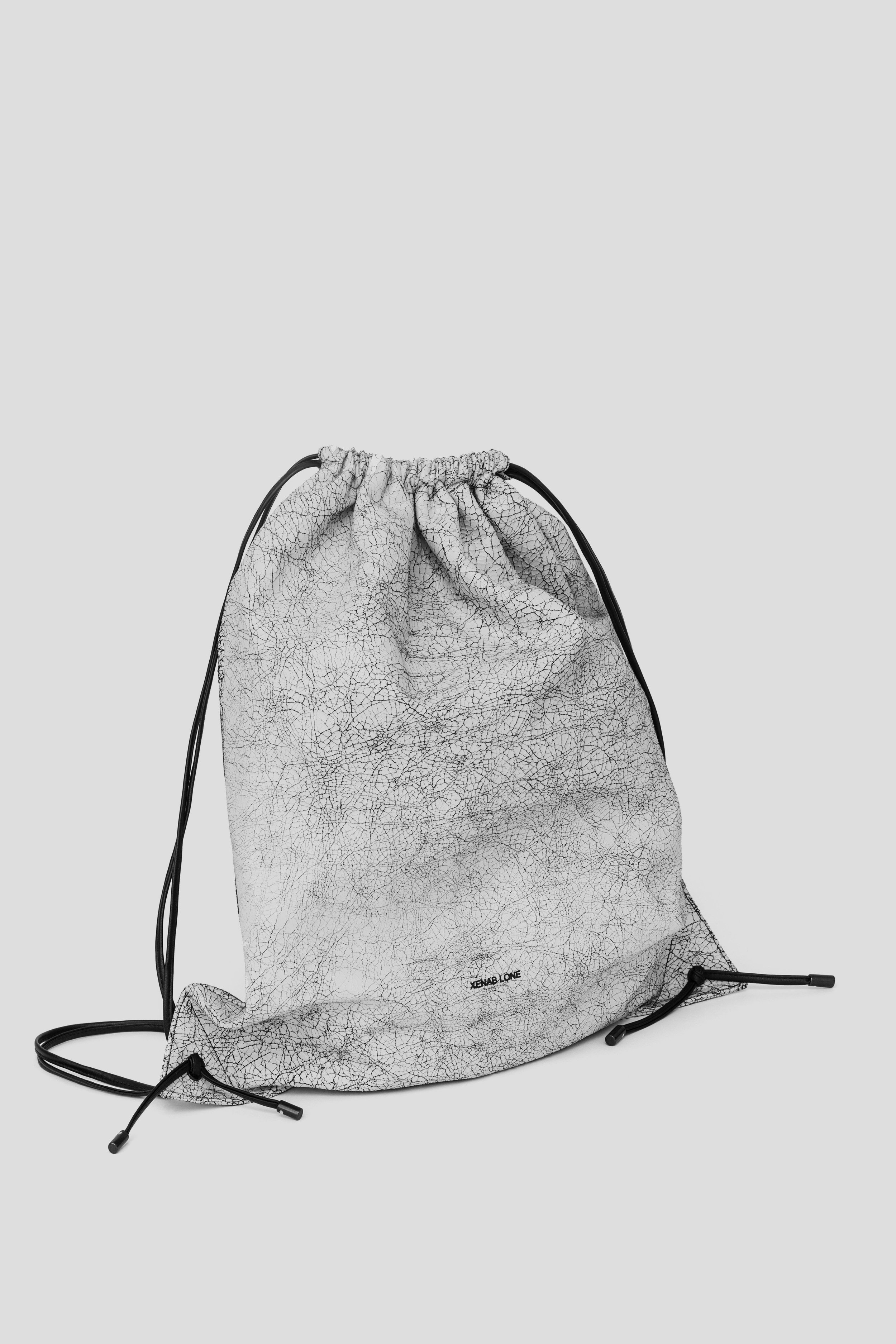 DRAWSTRING CRACKED FRONT.jpg