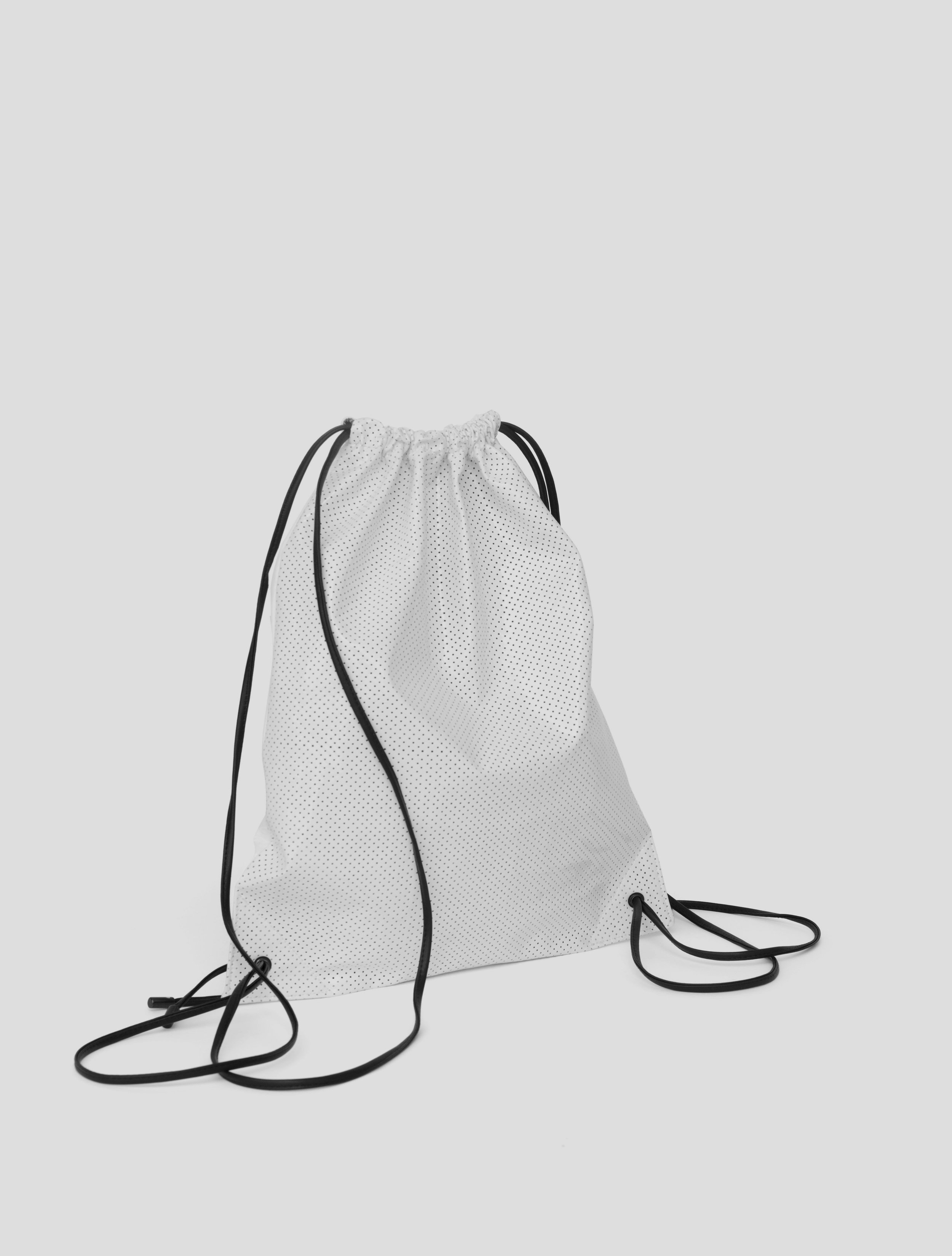 DRAWSTRING WHITE PERFORATED BACK.jpg