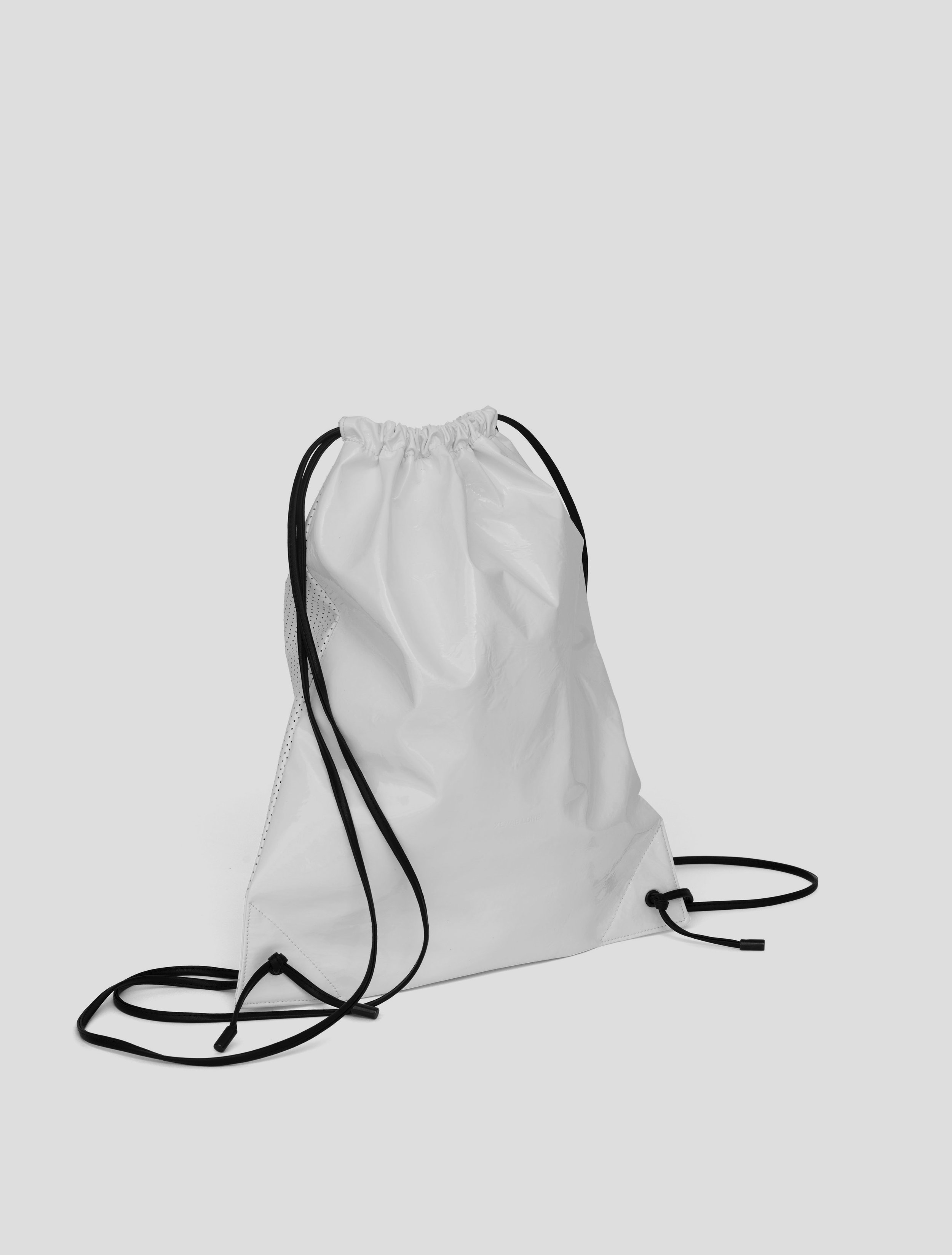 DRAWSTRING WHITE PERFORATED FRONT.jpg