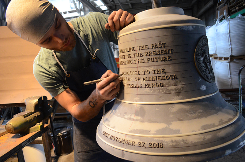Finishing - The bell is brushed clean to remove burnt epoxy. Small details, such as text are manurally refine. Depending on the desired finish of the bell, bells are polished, and coated with finishings such as patina.