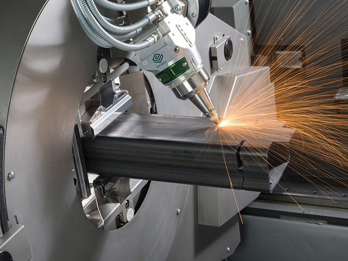 Tube Laser - The tube laser is one of Versteell's most unique and significant pieces of machinery. A large percentage of the joinery that goes into making their furniture frames starts here. This multi-axis tool can be used to cut steel pipe on any side in any orientation.