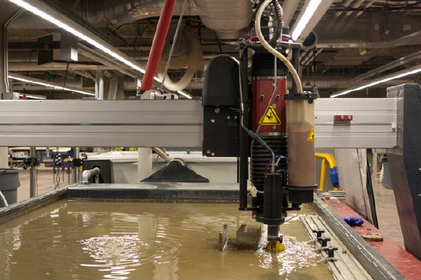 "Water Jet - Essentially an over powered power washer, a water-jet uses a high pressure stream of water and abrasive to cut through materials up to 8"" thick. Able to cut a wide variety of materials this tool proves to be extremely versatile."