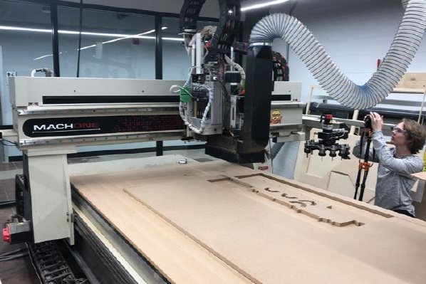 C.N.C. Router - Armed with a large format C.N.C. router sheet goods truly show their potential. This K.O.M.O. Mach One has auto tool change and a 5' x 10' bed easily fitting your project.