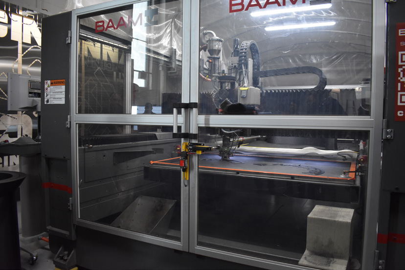 B.A.A.M. - B.A.A.M. (Big Area Additive Manufacturing) builds parts by layer and can build up to 80 lbs of material per hour. B.A.A.M. melts beads down, in place of filament, and dries them to remove moisture.