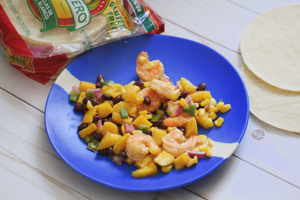 A flavorful shrimp taco recipe with sweet mangos, tangy shrimp, and spicy jalapenos. This recipe is gluten free and high in protein and nutrients, be sure to add this one to your menu this week!