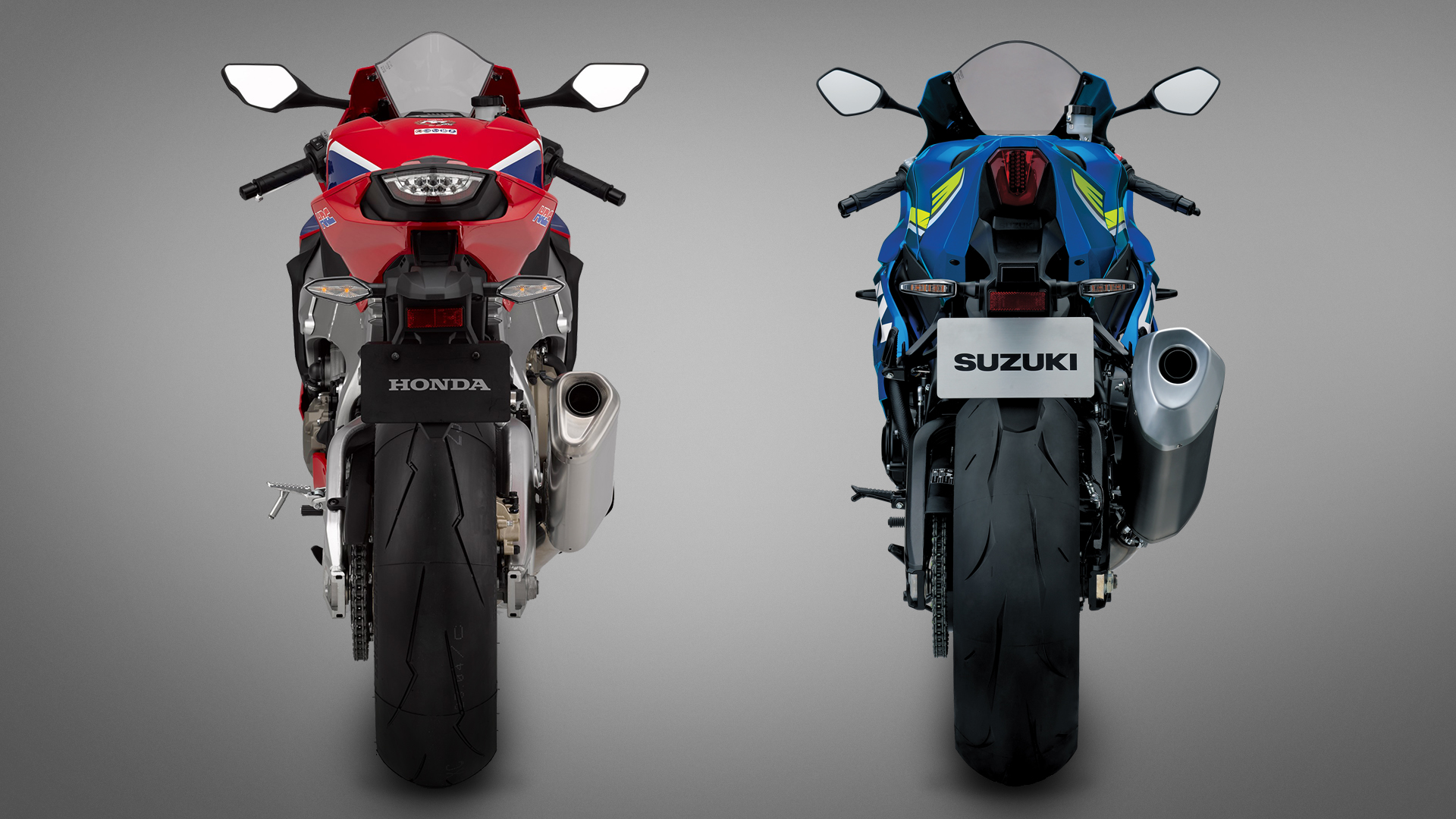 Suzuki's narrow tail section is finished off with a sleek brake light, but that exhaust is a whopper