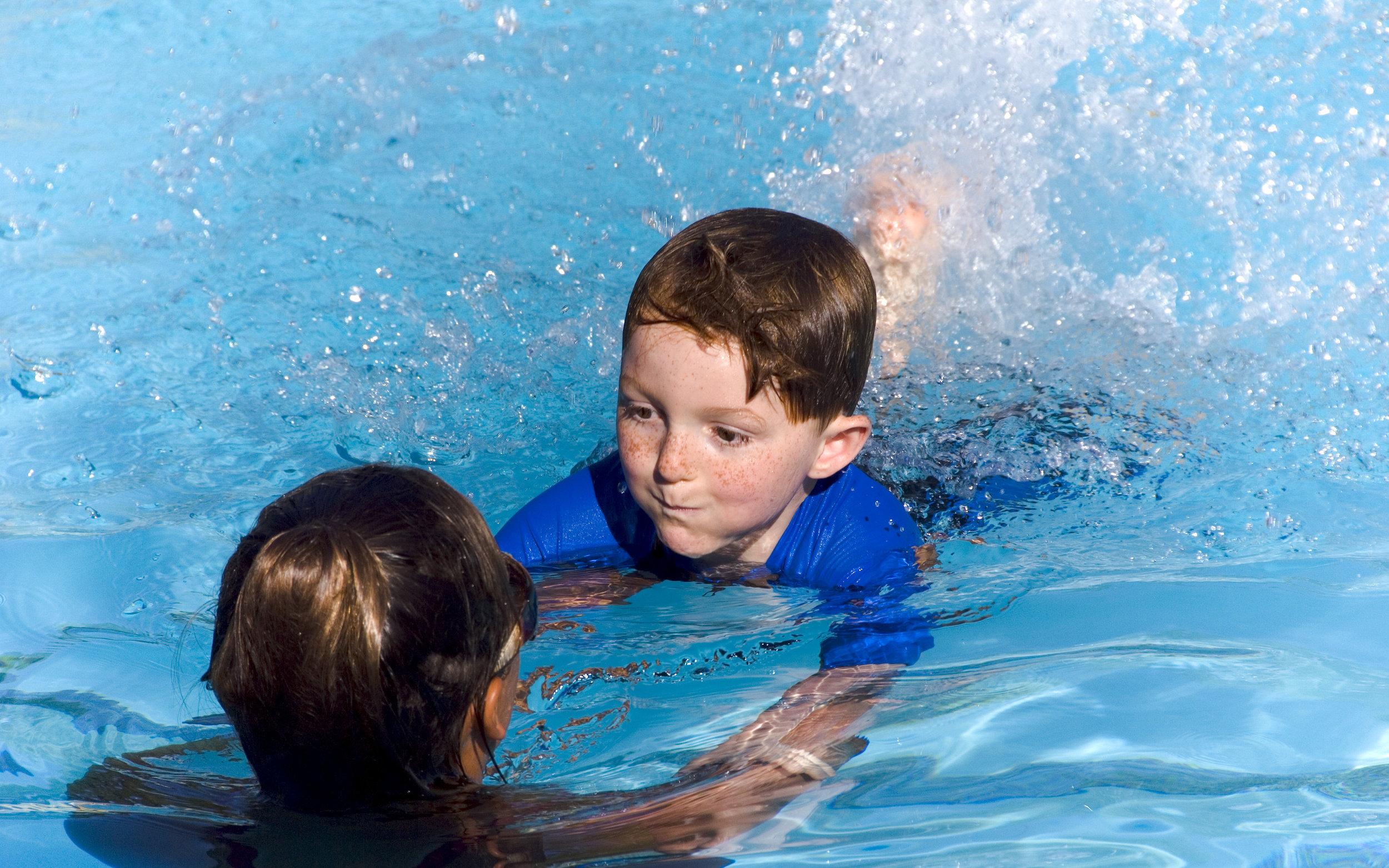 3991743-Child-Swimming-Stock-Photo.jpg