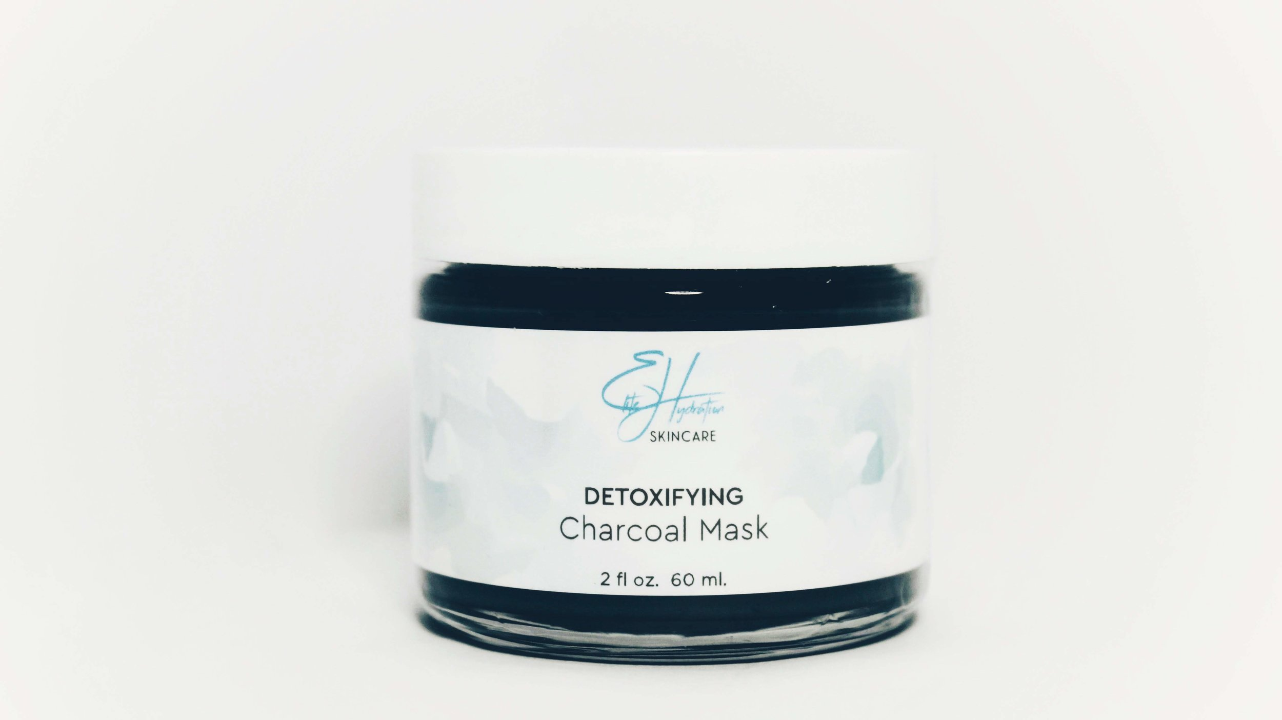 DETOXIFYING CHARCOAL MASK - ____WITH 3 EARTH CLAYS & ACTIVATED CHARCOAL- Gently cleanses stressed, polluted skin- Eliminates oils & dirt while reducing pores- Leaves face feeling refreshed & radiant