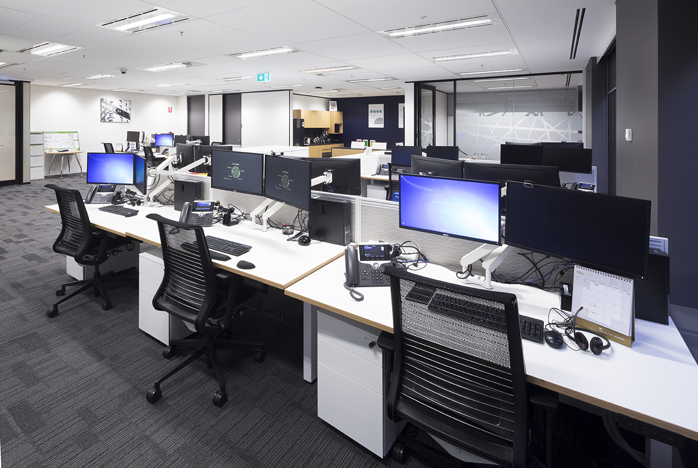 Workstations at BNY Mellon optimised for ergonomics and productivity in an open plan setting.