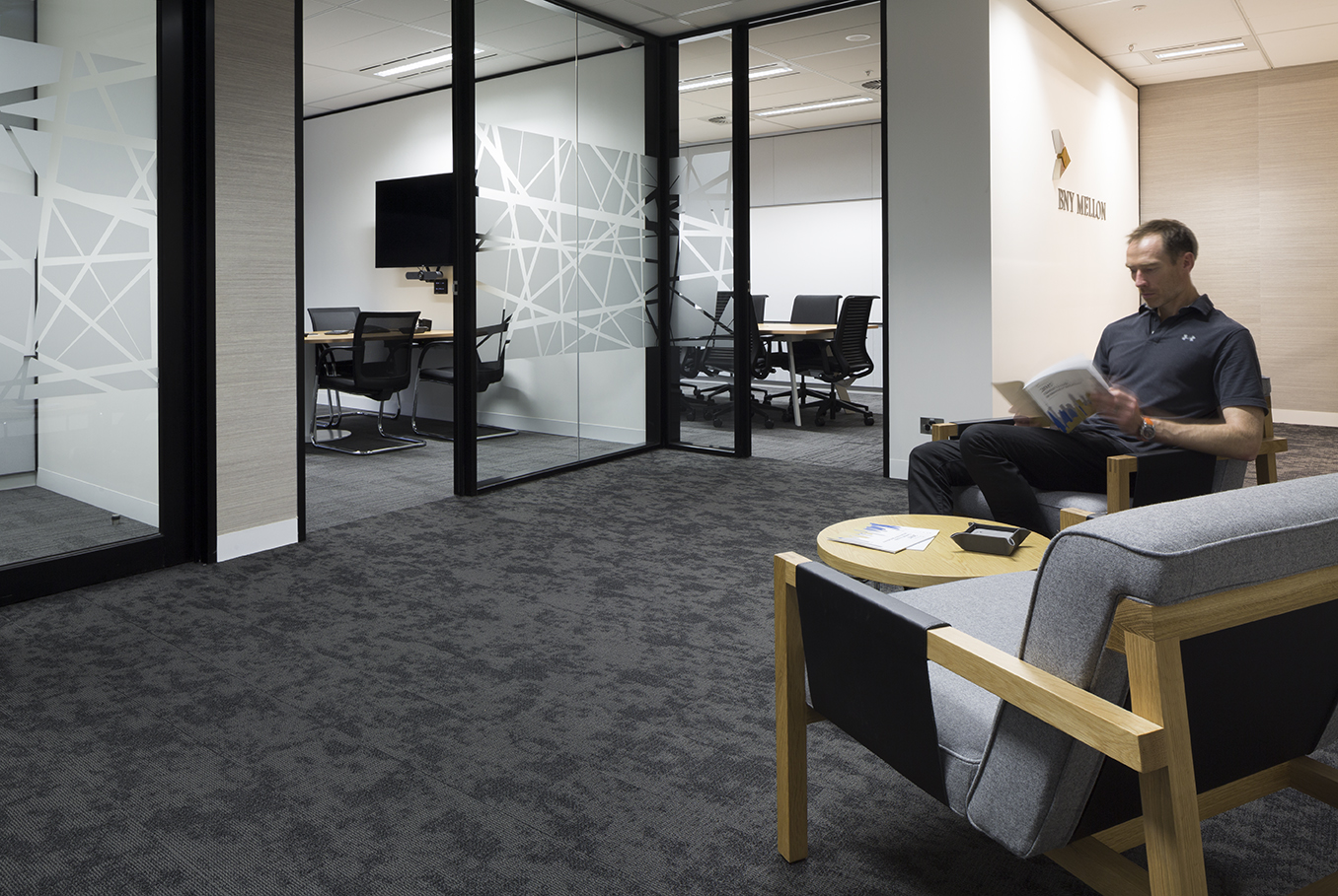 Tall Architects director Shane Wintershoven demontrating the lounge areas at BNY Mellon in the Melbourne CBD.