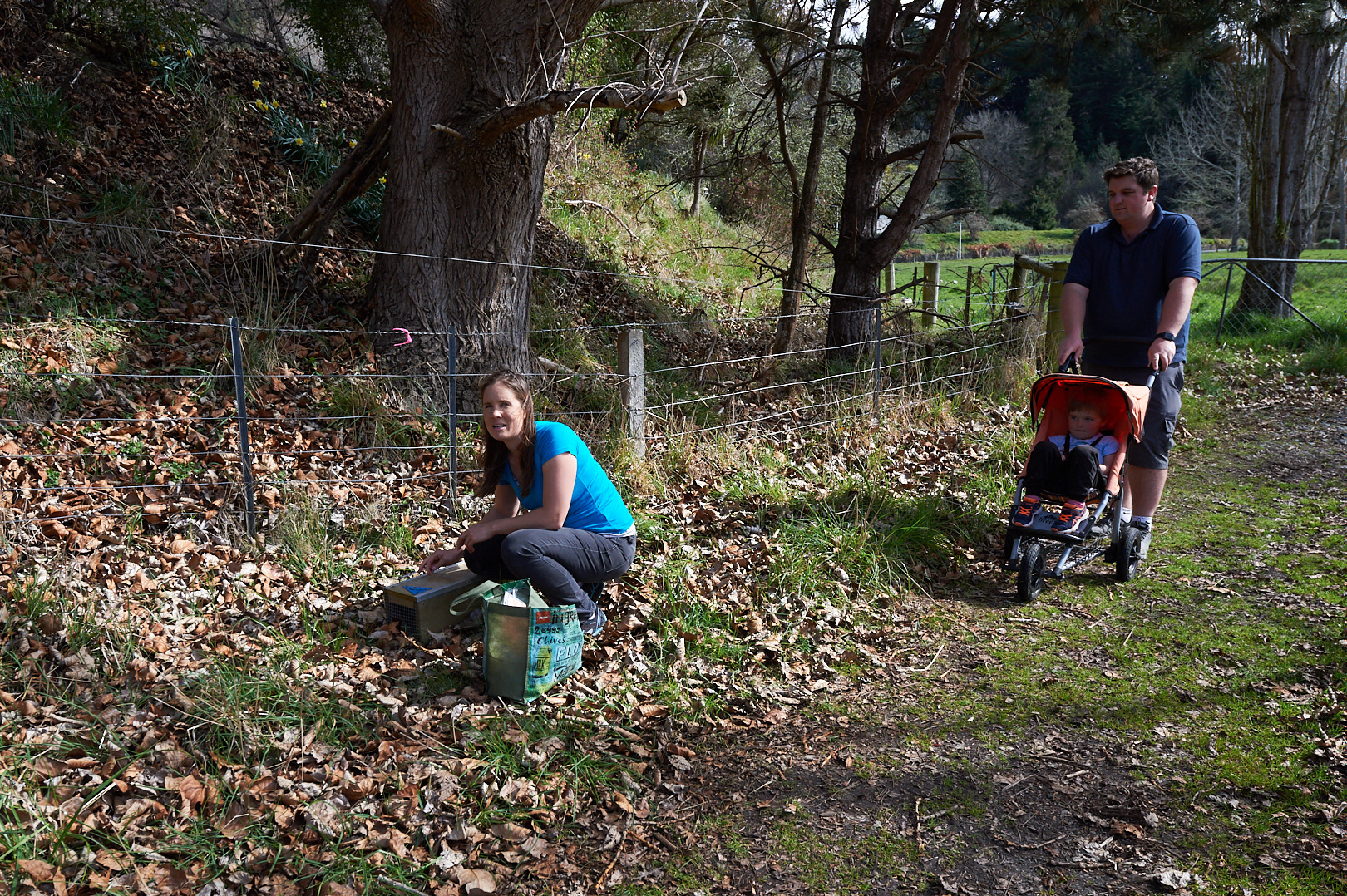 Volunteers checking traps on their family walk