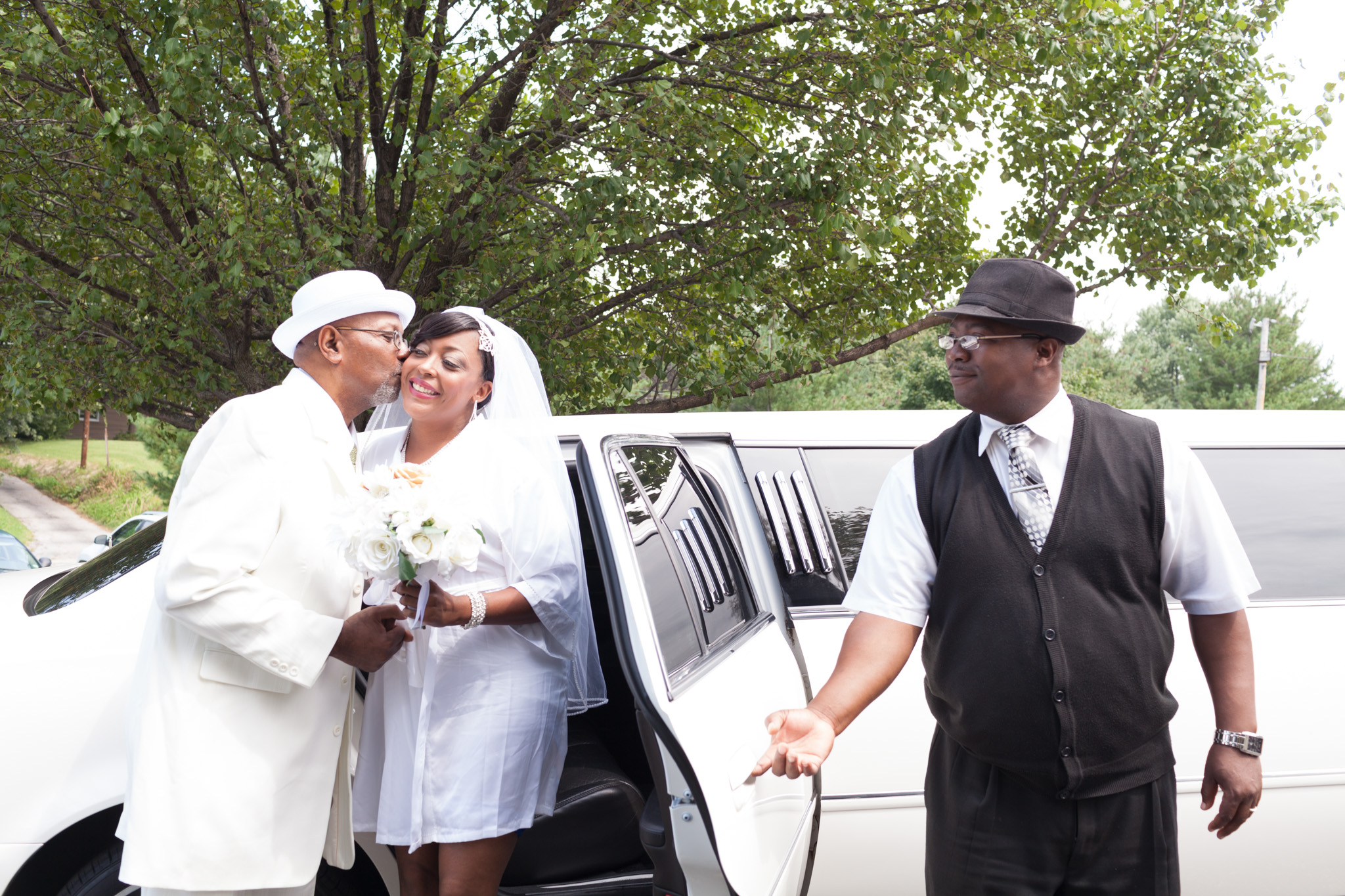 Crystal arriving in style. Her handsome father gives her a little kiss for good luck.