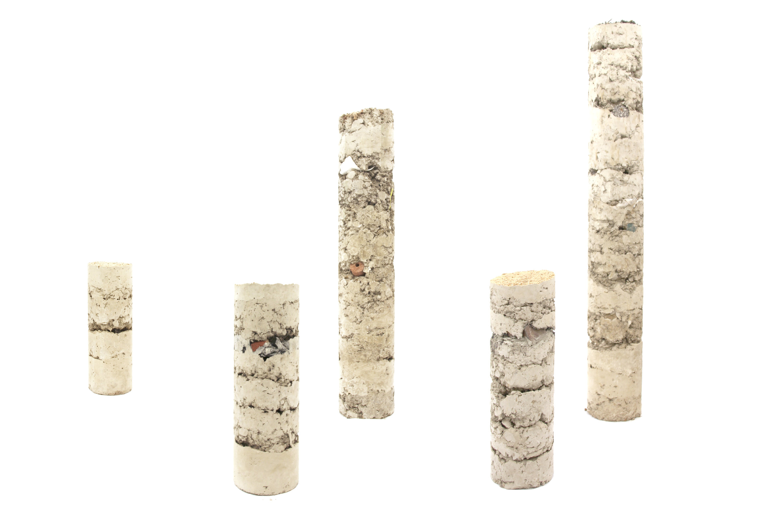 Soil (with everything it contains) and cement.  Approximate Core  site marker prototypes.