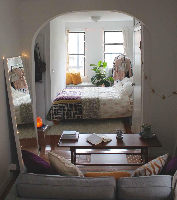 Bedding:  Anthropologie  // Window Seat:  West Elm  // Clothing Rack:  IKEA  // Flokati Rug:  World Market  // Coffee Table:  West Elm  // Leaning Mirror:  IKEA