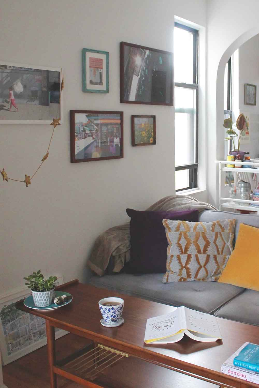 Sofa:  World Market  // Throw Pillows:  World Market  +  West Elm  // Coffee Table:  West Elm  // Framed Photography: By Me :) // Printed Mug:  IKEA