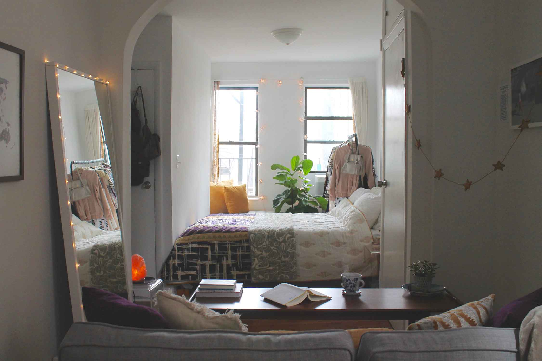 Bedding:  Anthropologie  // Window Seat:  West Elm  // Clothing Rack:  IKEA  // Coffee Table:  West Elm // Leaning Mirror:  IKEA