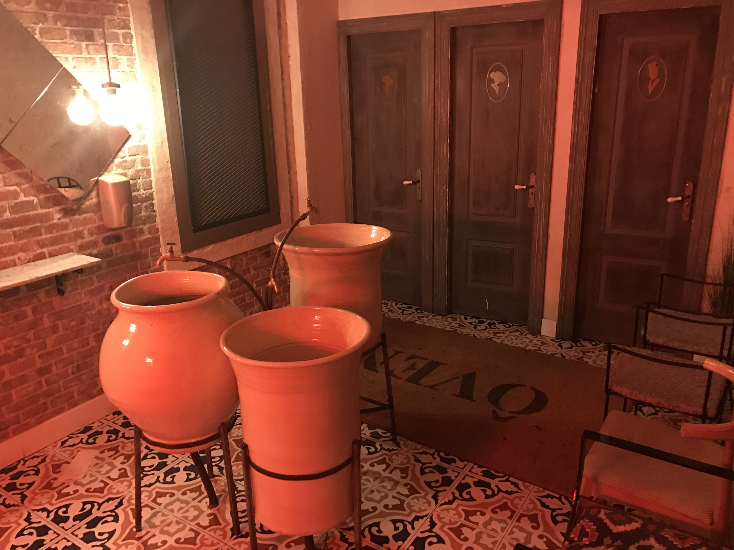 This was the bathroom. Which I had to take a picture of because these large urns are the sinks!