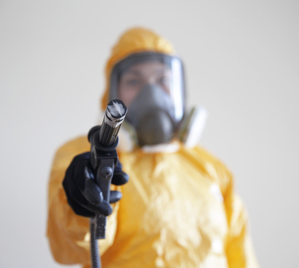 Person in yellow hazmat suit about to do a meth decontamination.