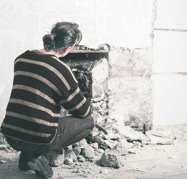 Lady-inspects-fireplace.jpg