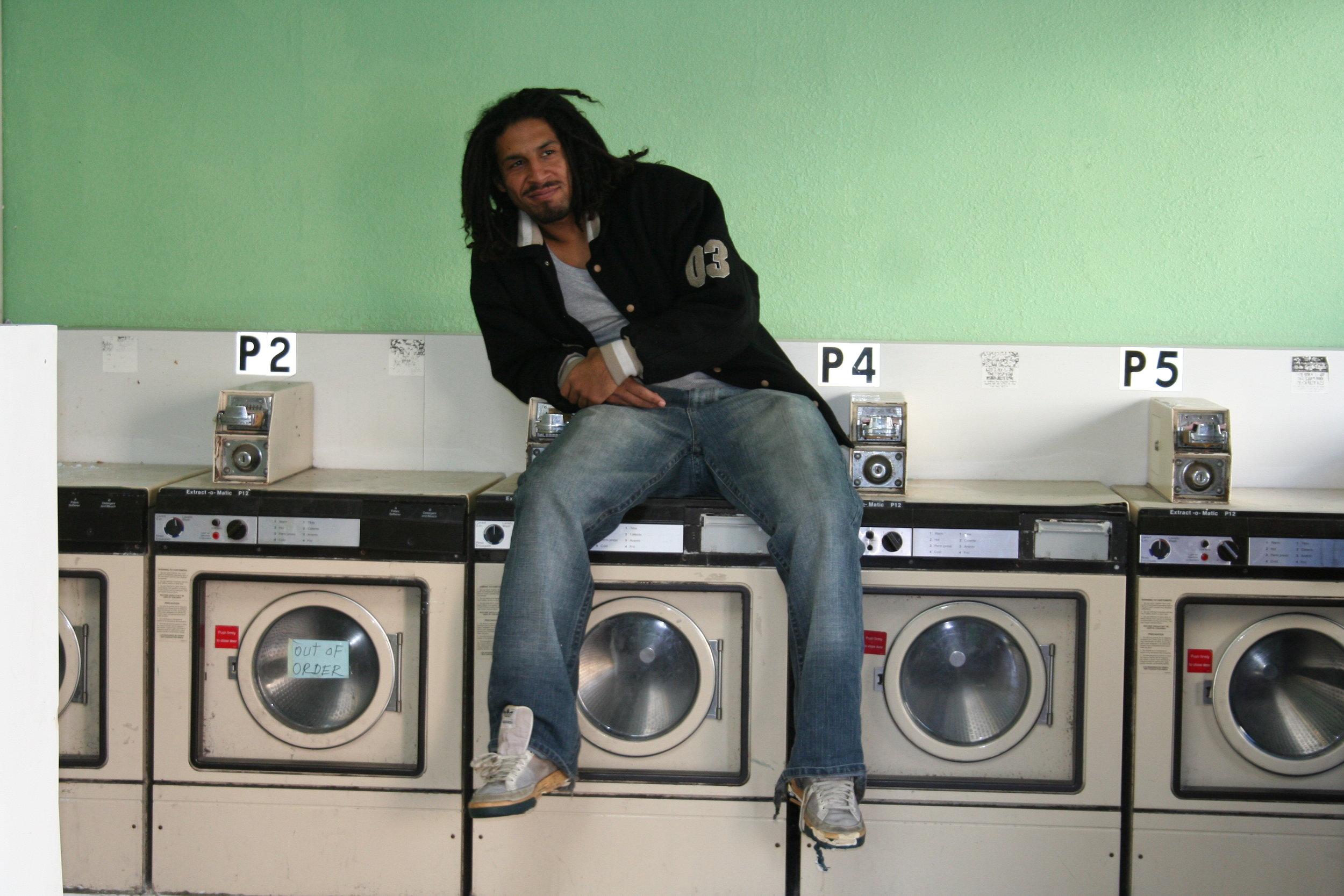 JSS sitting on washing mach.JPG