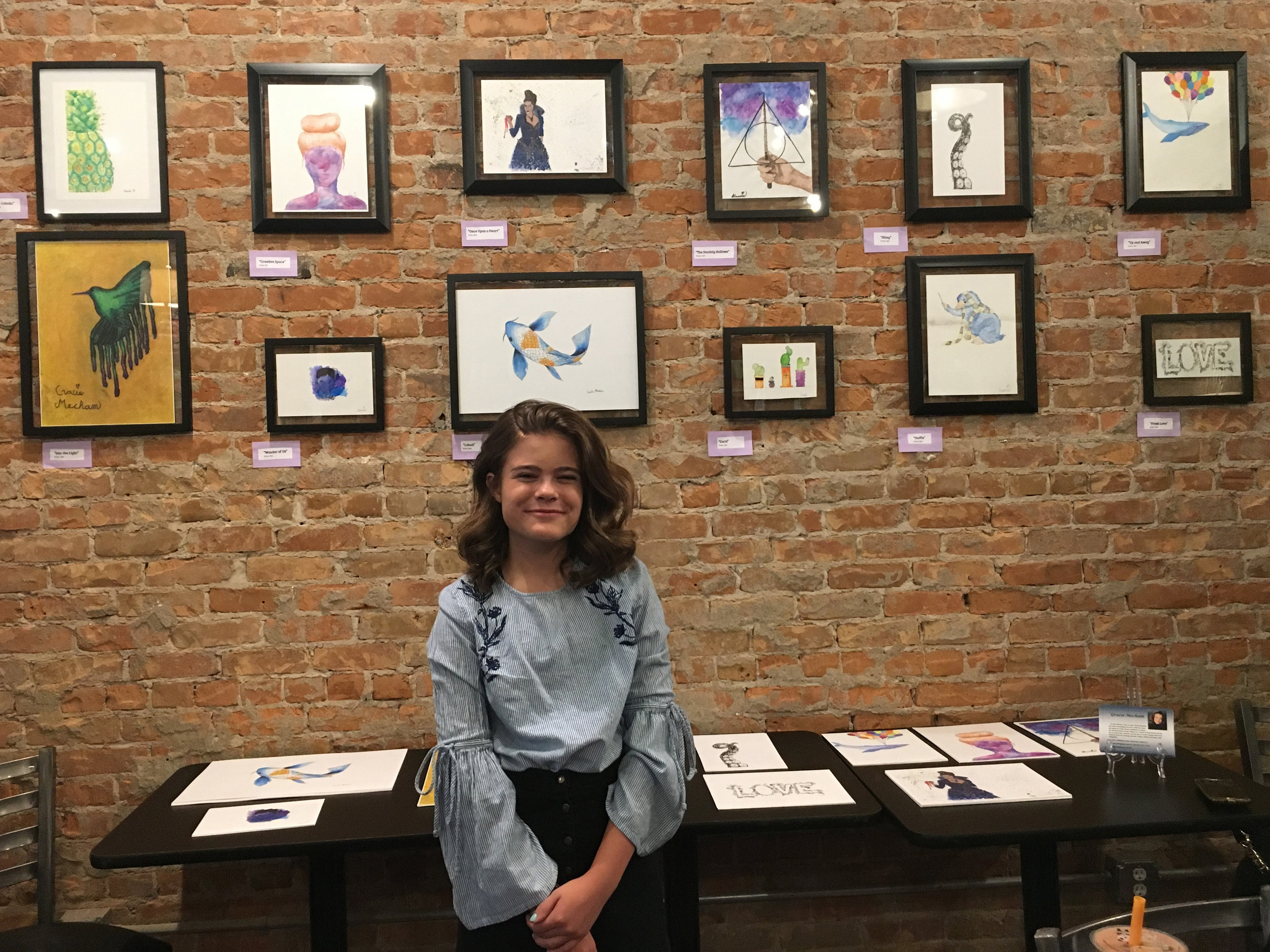Thirteen-year-old Gracie shows off her work at First Friday Art Stroll September 2018.