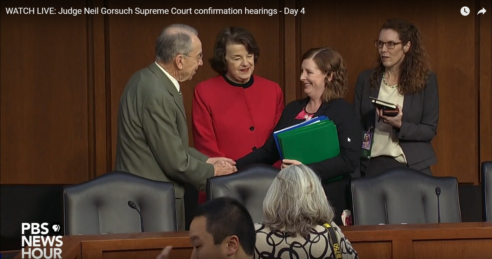 Meeting Senator Feinstein and Senator Grassley. Photo from PBS NewsHour