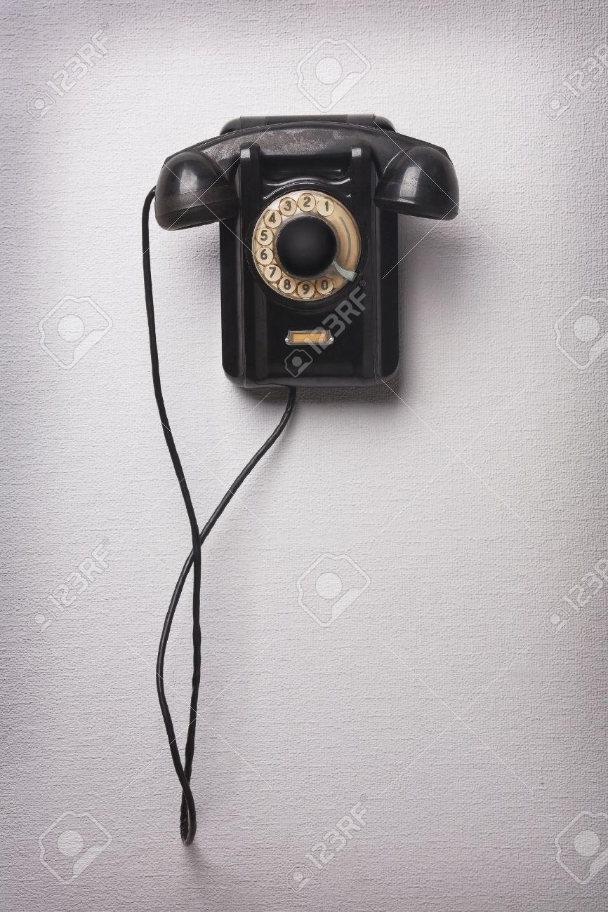 14531446-Old-black-rotational-phone-on-wall-Stock-Photo-telephone.jpg