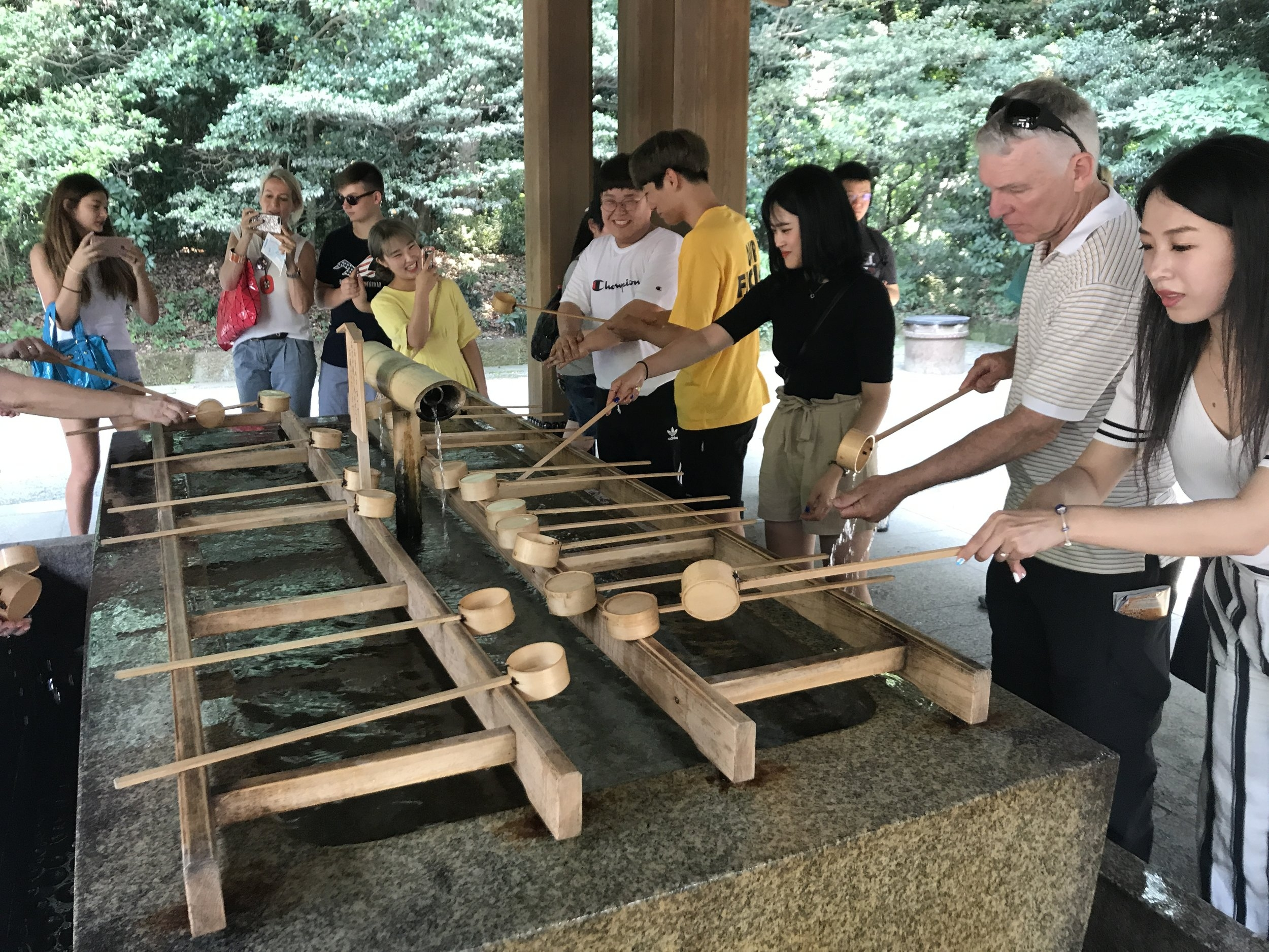 Washing hands at a shrine