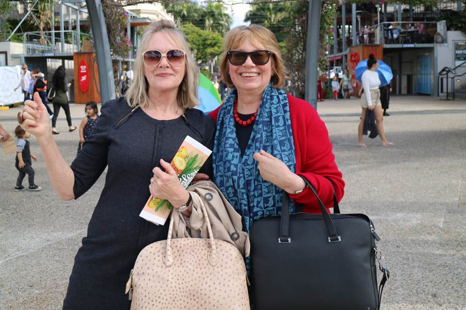 Roslyn (right), with colleague. Showing off her travel style.