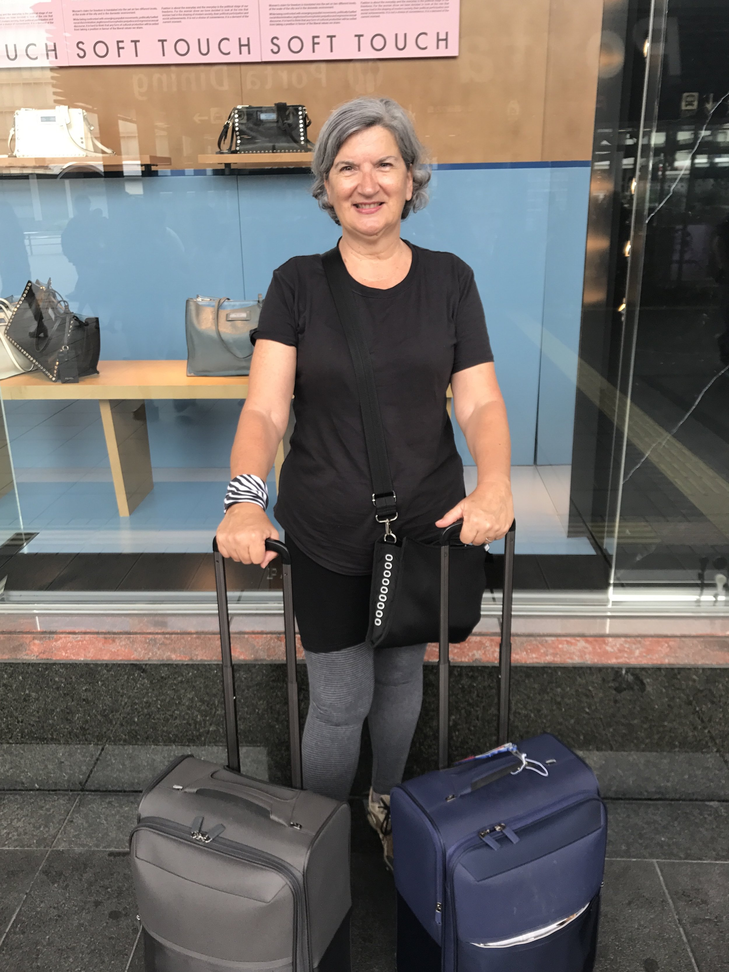 Here i am ready for a long haul trip from Kyoto to Tokyo, Melbourne and Canberra, wearing my typical on board wardrobe of leggings, shorts and t-shirt. Also showing off Mr PetMan and my carry-on luggage only: matching light Samonsite bags. And using my  Airpocket  as a handbag.