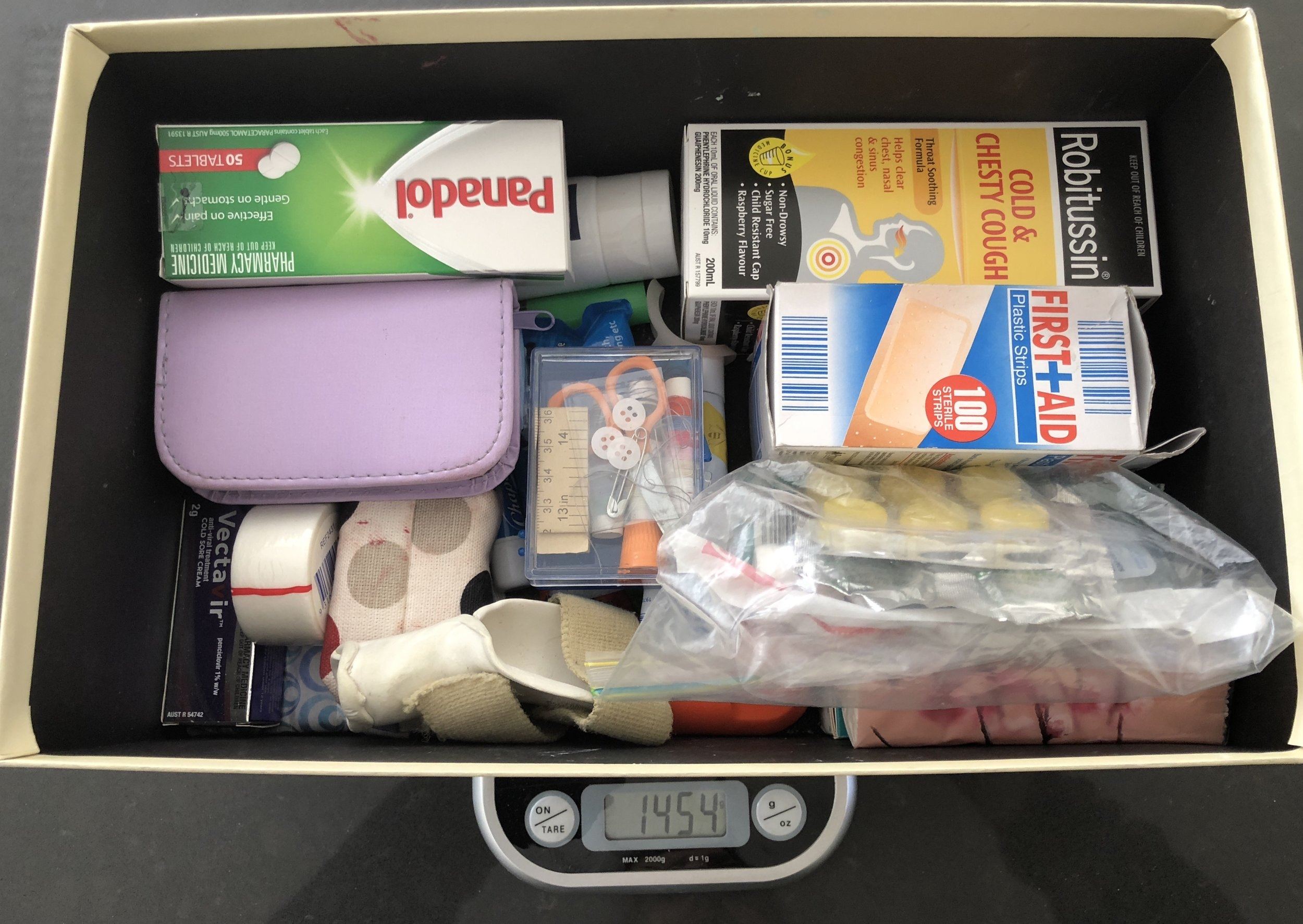 My home medical box weighs in at 1.5 kgs - this is not what I travel with!