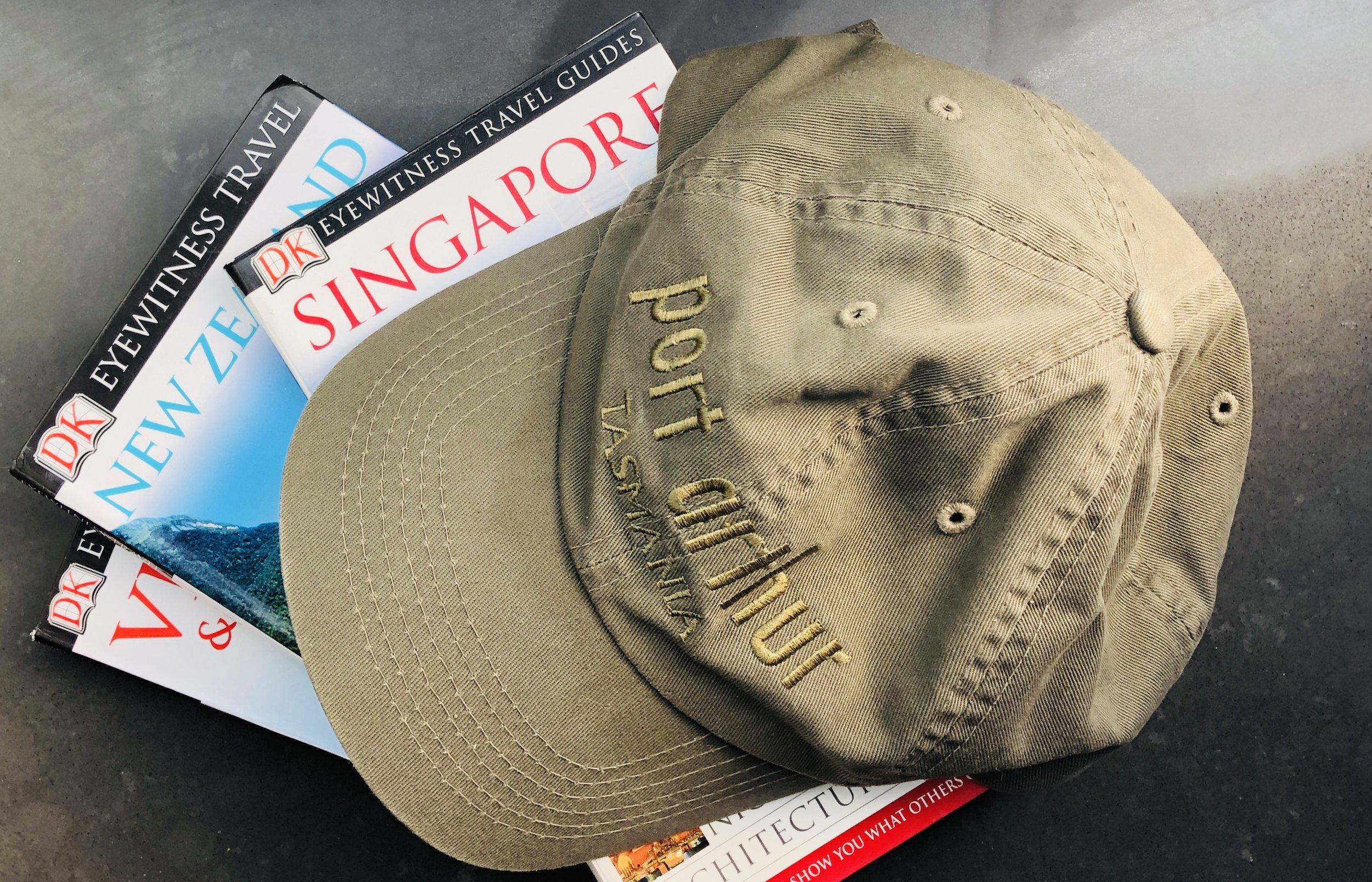 Peak caps: the ubiquitous tourist badge. Photo by Slobodanka Graham