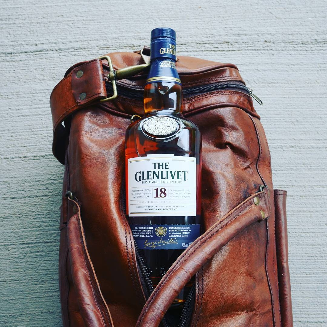 Adam's favourite whiskey in his leather weekend bag