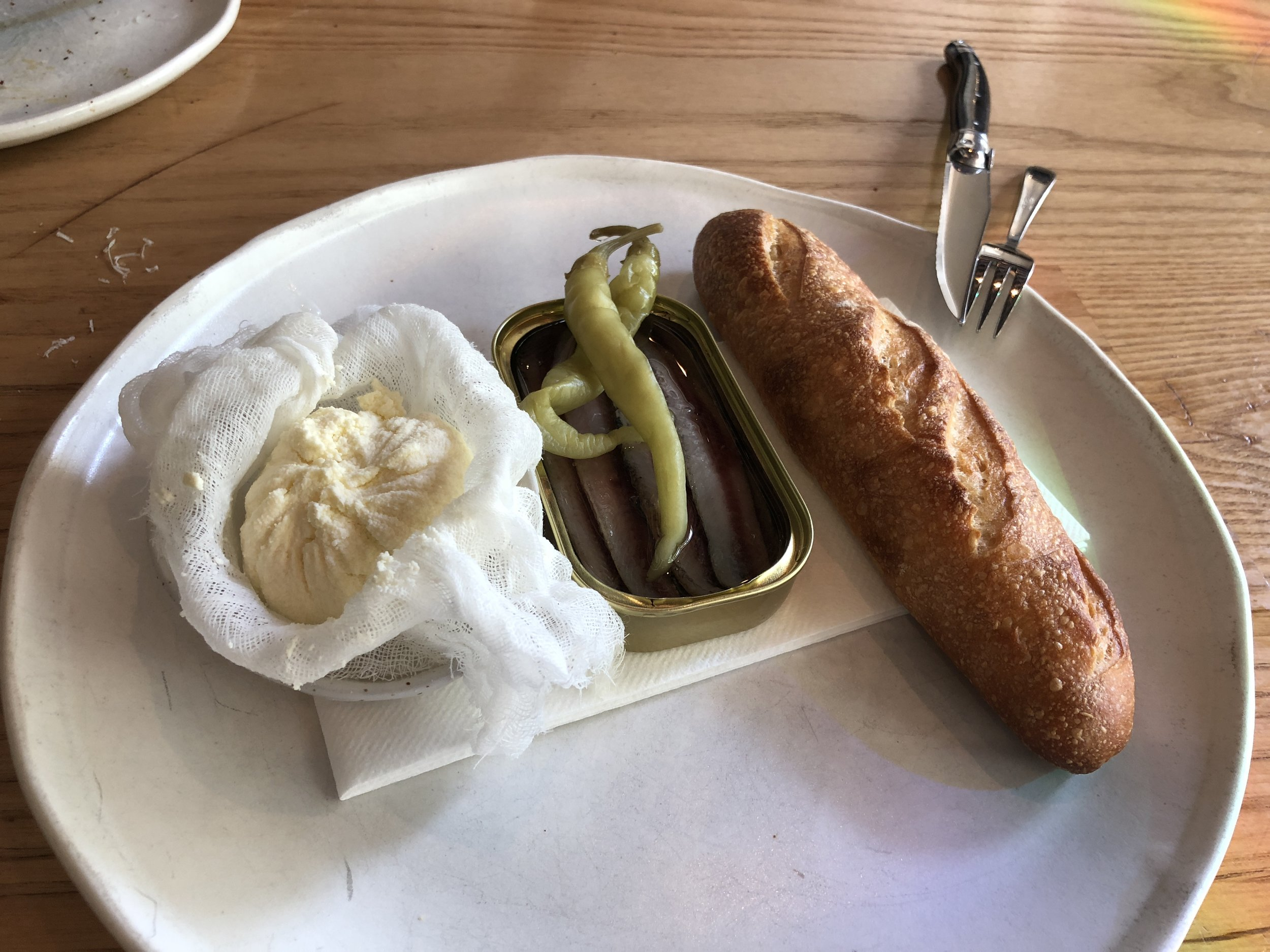 Smoked anchovies with ricotta and sourdough bread (photo by Slobodanka Graham)