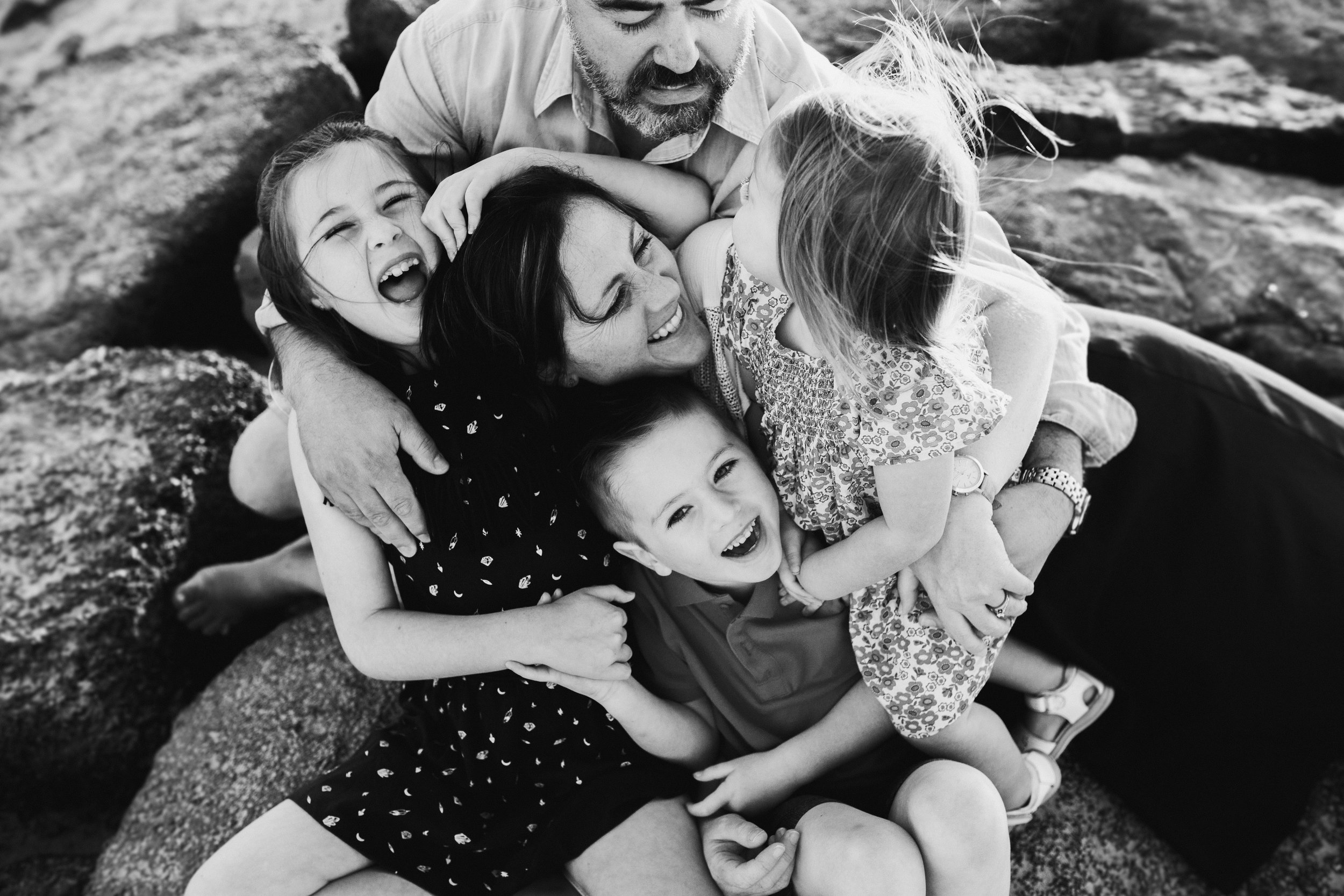 When I saw our photos I was so glad that we had taken the plunge! They are full of love and happiness. My biggest fear was that it would be a waste of time and we wouldn't get any great photos because we were tired, run down or that the kids would be cranky.  Thank you for capturing photos of us just having fun and enjoying our children, they are the photos I really needed to have.  And thank you for getting us together for real family time, I loved it so much. I got so much enjoyment out of just focusing on us and making each other laugh, smile and play. THANK YOU!  - Kate