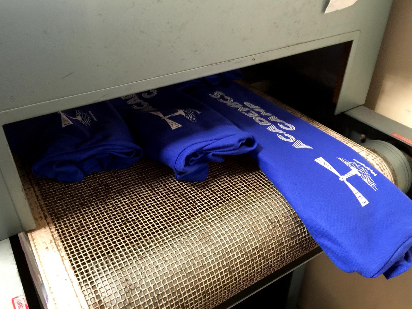 Running the shirts through the dryer.