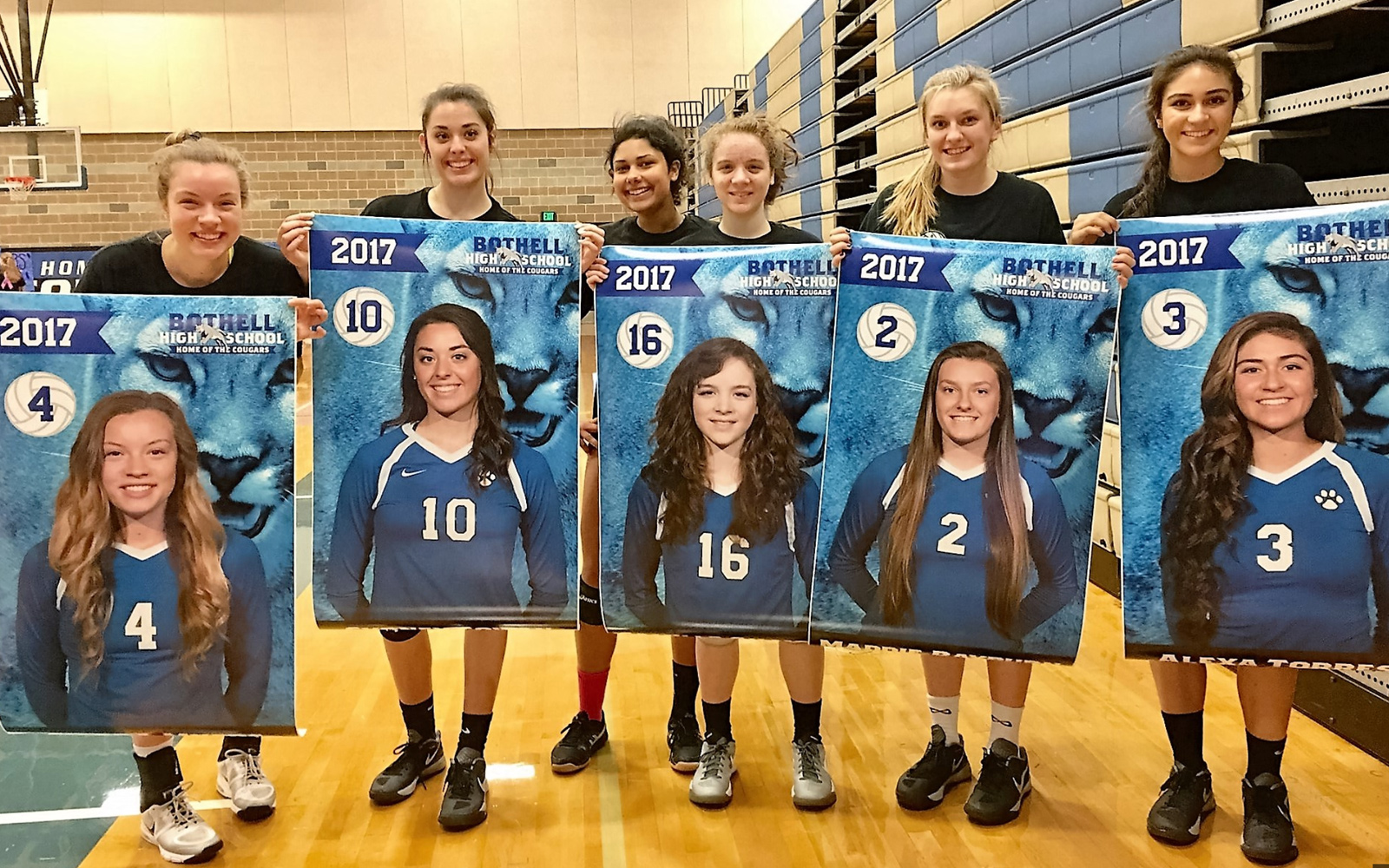 Sweet photo of the seniors with their banners. This is why I love my job!